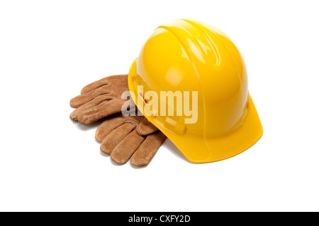 Yellow hard hat with work gloves - Stock Photo