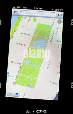 New Apple's iOS 6 Maps app showing satellite view/detail of the Central Park, NYC on the screen of a new iPhone - Stock Photo