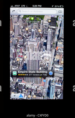 3D satellite view of the Empire State Building shown in a new Maps app on the screen of a iPhone 5/iOS 6 - Yelp - Stock Photo