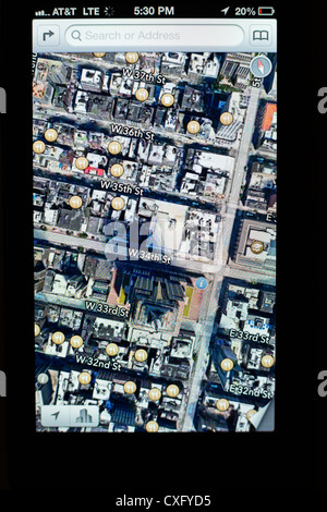 Satellite view of the Empire State Building shown in a new Maps app on the screen of a iPhone 5/iOS 6 - Yelp reviews, - Stock Photo