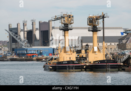 Ammunition loading barges Devonport Royal Dockyard Plymouth Devon UK Stock Photo