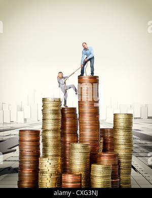 man and woman on euro coin pile - Stock Photo
