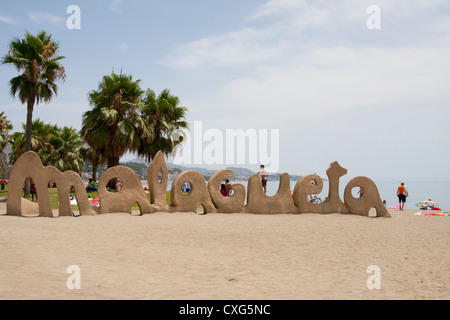 Malagueta sign on the beach at Malaga on the Costa del Sol in southern Spain - Stock Photo