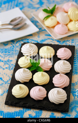 Meringues three flavours. Recipe available - Stock Photo