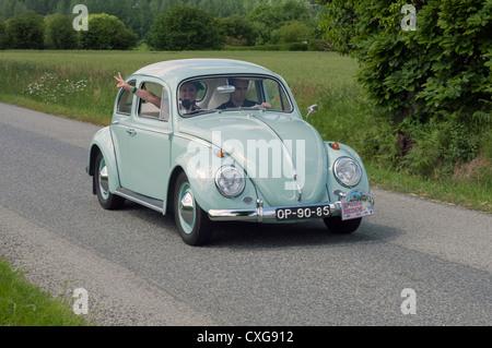 Volkswagen Beetle in the Tour de Bretagne, France 2012 - Stock Photo