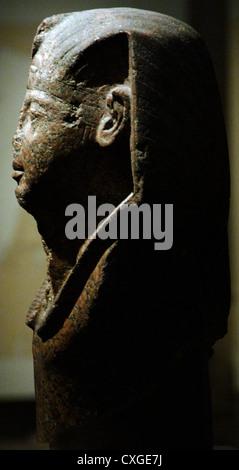Head of Pharaoh, probably Ramesses II. Red granite. 19th Dynasty. New Kingdom. 1250 B.C. British Museum. London. - Stock Photo