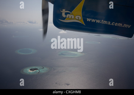 Viewing resort from seaplane - Maldives - Stock Photo