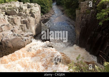 The River Tees crasheing over High Force waterfall in Moor House Upper Teesdale, County Durham - Stock Photo