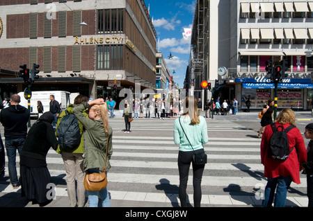street scene in Stockholm Sweden Swedish capital Scandinavia Scandinavian Scandinavians people swedes blonde blonde's - Stock Photo
