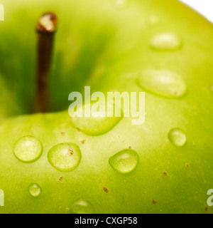 Green apple with waterdrops on its surface - Stock Photo