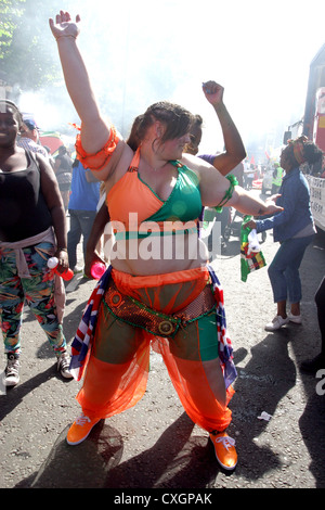 Overweight woman dancing at Notting Hill Carnival London - Stock Photo