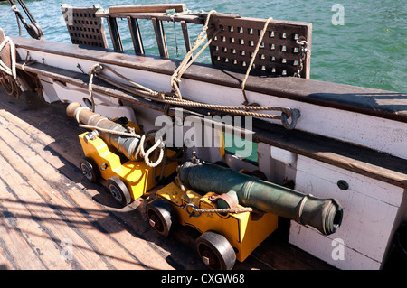Cannons on Tall Sailing Ships in Harbour of San Diego California USA - Stock Photo