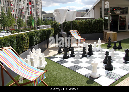 Giant chess board and pieces in the athletes village. Part of the London 2012 Olympic and Paralympic games - Stock Photo
