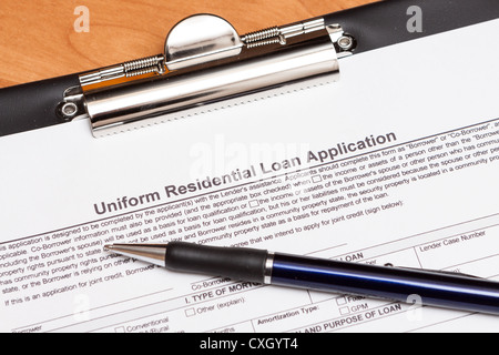 Mortgage loan application form on the table - Stock Photo
