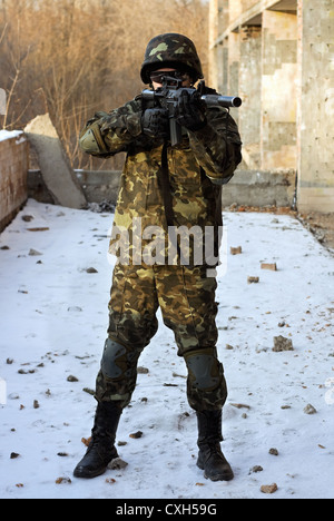 Soldier in camouflage with rifle - Stock Photo