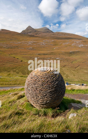 Cul Mor and the Globe artwork made by Joe Smith from Moine Shist at Knockan Crag, NW Scotland.  SCO 8558 - Stock Photo