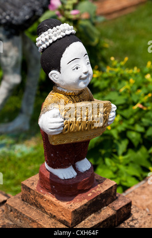 Little Statue in the Temple Wat Buppharam in Chiang Mai in Thailand - Stock Photo