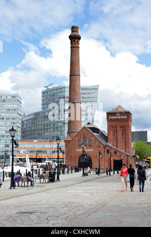 The Albert Dock tourist complex in Liverpool, Merseyside, with modern office blocks in the background. - Stock Photo