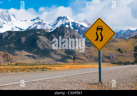 slippery when wet warning road sign - Stock Photo