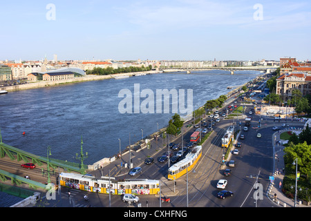 Budapest city life, cars, trams, street traffic along Danube river in Budapest, Hungary. - Stock Photo