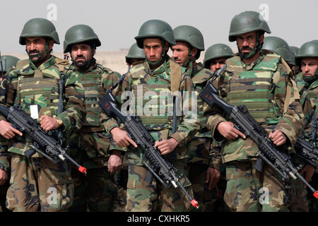 Members of the Afghan National Army stand in formation at the Combined Fielding Center March 10, 2010 at Camp Black - Stock Photo