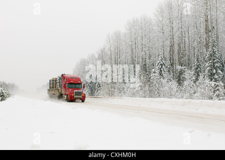 red truck on winter road - Stock Photo