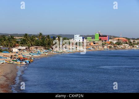 Fishing boats unloading their catch on Back Bay beach in Trincomalee, Sri Lanka. - Stock Photo