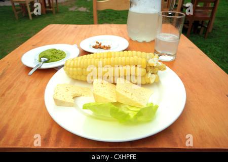 Choclo con queso dish in a restaurant, Urubamba, Cuzco, Peru - Stock Photo