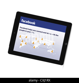 Facebook on the New Generation iPad tablet from Apple - Stock Photo