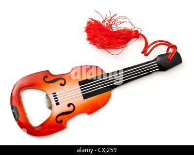 Novelty guitar shaped bottle opener - Stock Photo