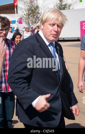 London 2012 Paralympics , Olympic Park Stratford , Lord Mayor Boris Johnson greats crowd while dashing round venue - Stock Photo