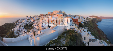 Greece, View of Oia village in sunset at Santorini - Stock Photo