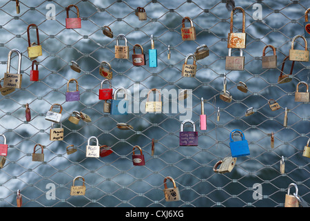 Austria, Styria, Graz, View of padlocks on Hauptbruecke Bridge - Stock Photo