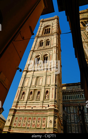 Directly next to the Duomo di Santa Maria del Fiore, in Florence, stands the Campanile or bell tower' designed by - Stock Photo