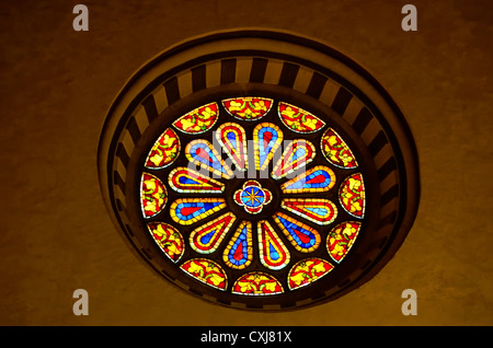 Stained Glass Window at the Basilica di Santa Croce in Florence, Italy - Stock Photo