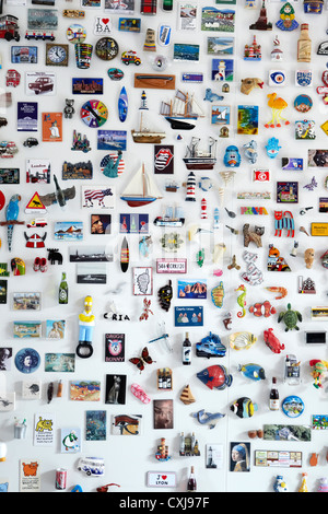 Fridge Magnet collection, showing magnets from around the world. Horizontal version also. - Stock Photo