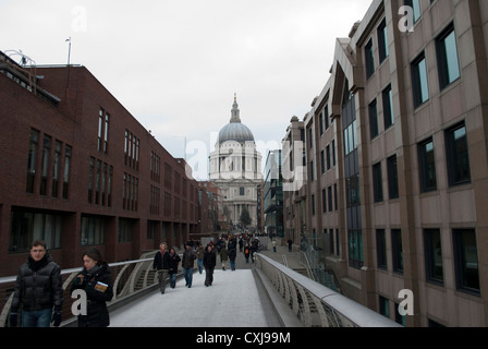The dome of St Paul's Cathedral seen from the end of the Millennium Bridge and Peter's Hill - Stock Photo