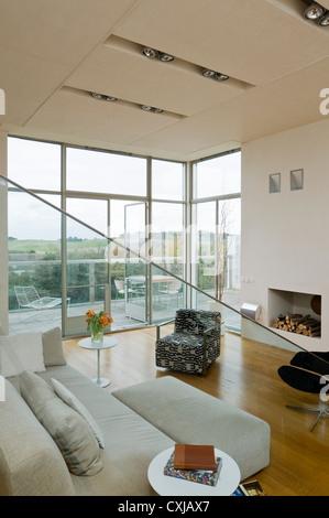 Split-level open plan living room and kitchen - Stock Photo