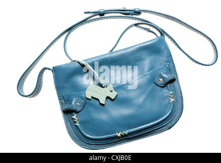 Radley designer handbag with shoulder strap in blue leather with Scottie dog logo tag cut out and isolated on a - Stock Photo