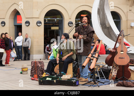 Irish buskers performing in the street by the Spriti of Belfast sculpture in Arthur Square Belfast Co Antrim Northern - Stock Photo