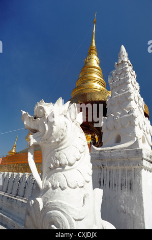 The public white stone lions. Situated in front of the pagoda sunny day. - Stock Photo