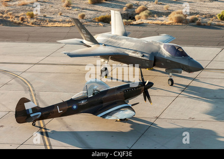 US Air Force F-22 Raptor stealth fighter aircraft next to a World War II Spitfire aircraft at Edwards Air Force - Stock Photo