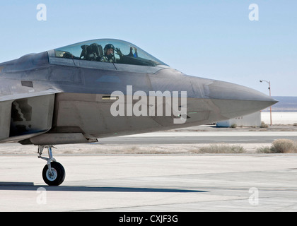 US Air Force F-22 Raptor stealth fighter aircraft taxi's at Edwards Air Force Base March 13, 2012 in Edwards, California. - Stock Photo