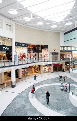 Interior of Manchester Arndale shopping centre center, showing Next and River Island. - Stock Photo