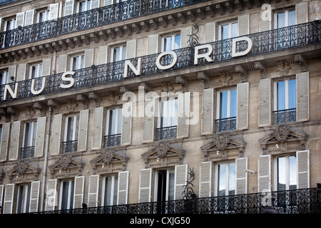 Hotel opposite SNCF Paris Gare du Nord railway station in France, with typical french balconies and windows - Stock Photo