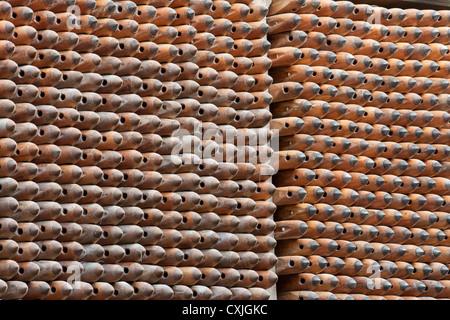 Masson Mills, Matlock, Derbyshire; view off bobbins stacked on shelve. - Stock Photo