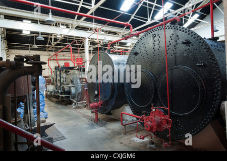 Masson Mills, Matlock, Derbyshire; view off boilers in boiler room. - Stock Photo