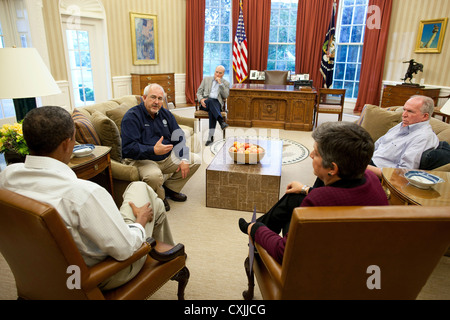 US President Barack Obama holds a meeting August 28, 2011 in the Oval Office to discuss the aftermath of Hurricane - Stock Photo