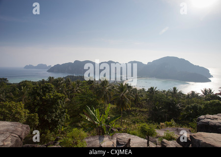 The isthmus as seen from the viewpoint. Phi Phi Lay Island seen top left in the distance. - Stock Photo
