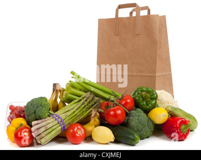 Grocery sack with fresh vegetables in front - Stock Photo